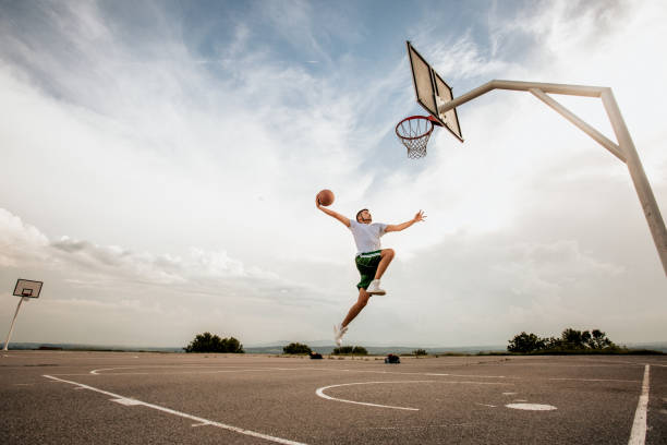 guy jumping on the rim